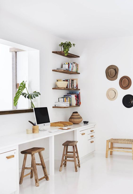 Boho office with wall hooks for hats