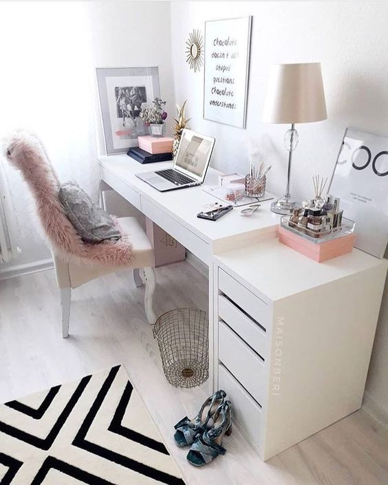 White inspiring office space for women with pops of pink