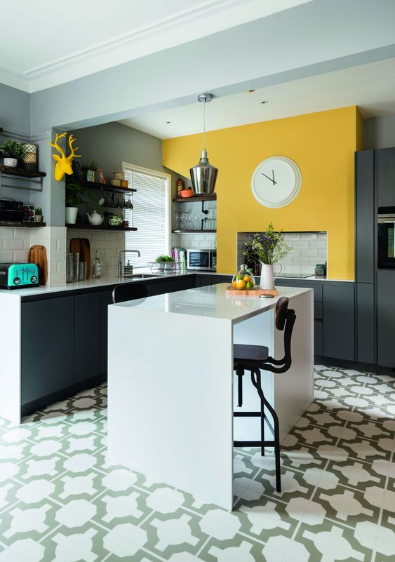 tiled and yellow wall kitchen