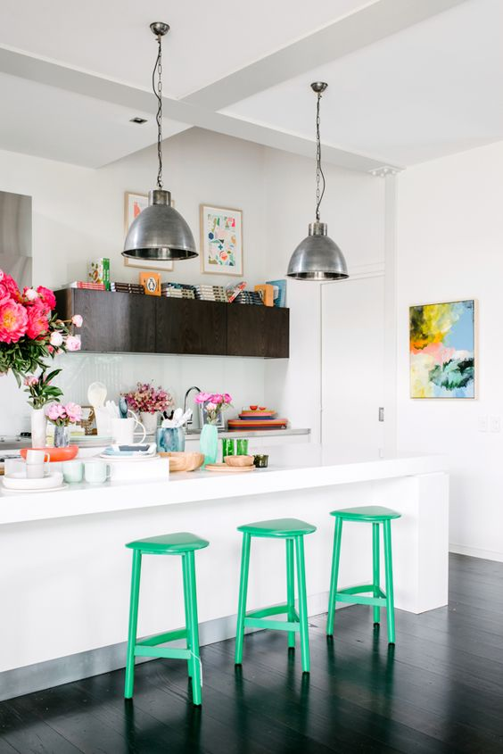 Green stools in kitchen